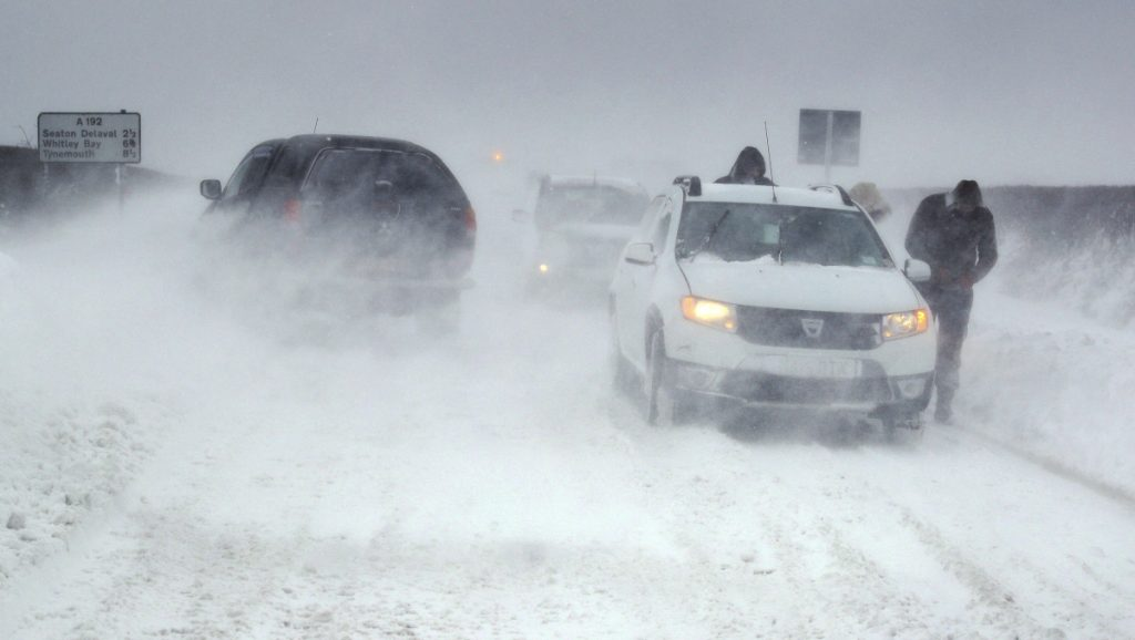 White-out conditions bring cars to a stop on a frigid section of highway near Blyth, north east England, on Thursday.