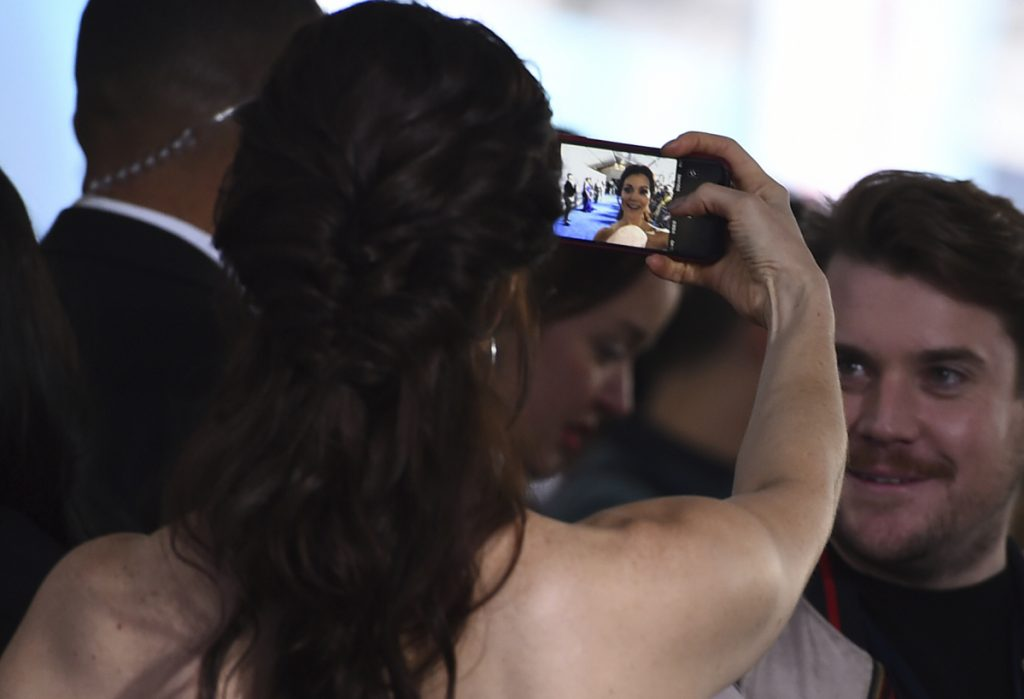 "Bellamy Young takes a selfie as she arrives at the world premiere of ""A Wrinkle in Time"" at the El Capitan Theatre on Monday, Feb. 26, 2018, in Los Angeles. (Photo by Jordan Strauss/Invision/AP)"