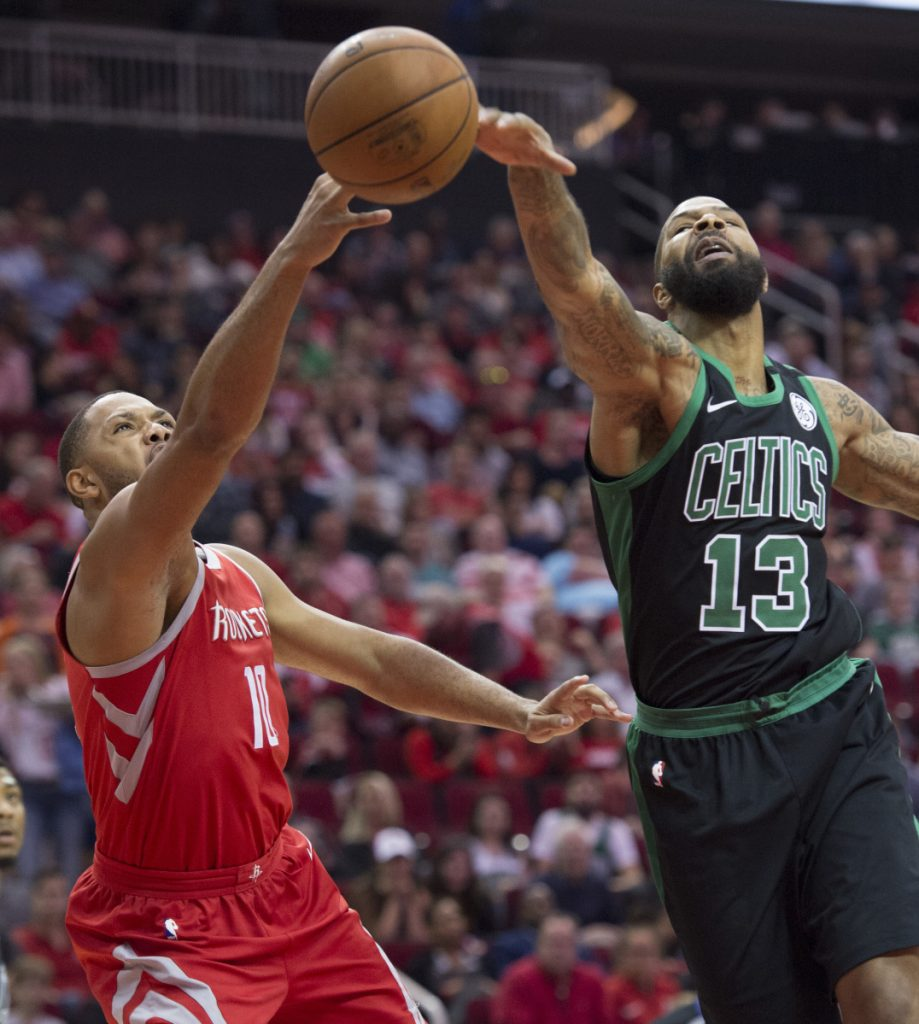 Celtics forward Marcus Morris blocks a shot by Houston's Eric Gordon during the Rockets' 123-120 win Saturday night in Houston.