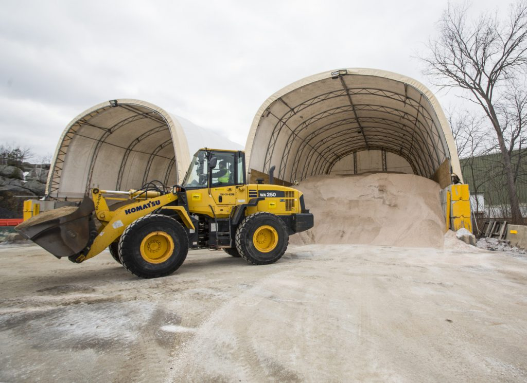 PORTLAND, ME - MARCH 6: Colby Waterhouse uses a loader to a fill truck with a mixture of sand and salt as city workers prepare for a winter storm expected to bring over a foot of snow to the Portland area. (Staff photos by Derek Davis/Staff Photographer)