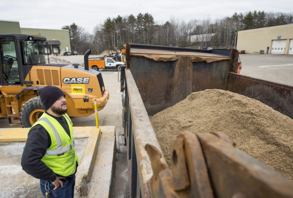 PORTLAND, ME - MARCH 6: Colby Waterhouse checks the level of mixture of sand and salt in a snow plow as city workers prepare for a winter storm expected to bring over a foot of snow to the Portland area. (Photo by Derek Davis/Staff Photographer)