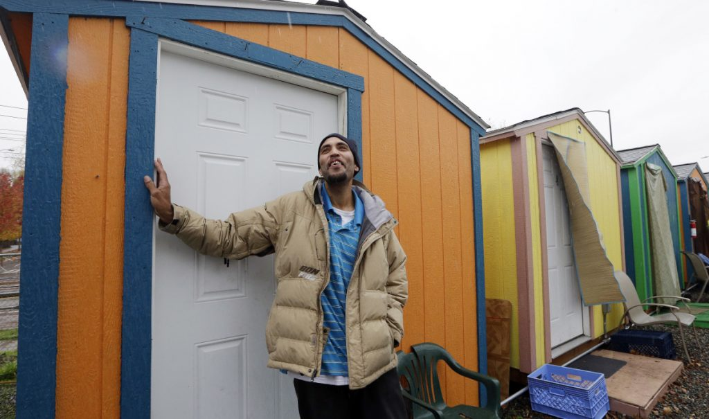 Tyson King stands at the door of his tiny house at a homeless encampment in Seattle in November. A local nonprofit started building the tiny houses, portable 120-square-foot shacks that can make up villages of 14 to 44 units. Washington state has 29 homeless people for every 10,000 state residents, according to a 2017 federal study. The national average, by comparison, is 17 people for every 10,000 residents.