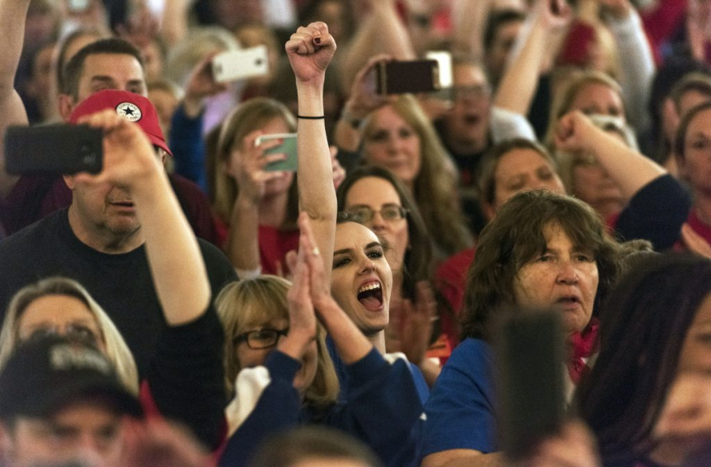 Teachers celebrate after the state Senate approved a bill to increase state employee pay by 5 percent at the capitol in Charleston, W.Va., on Tuesday.
