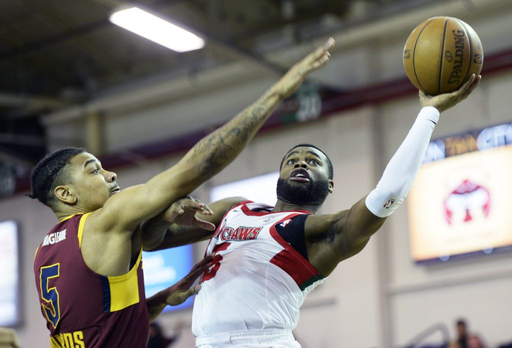 Kadeem Allen of the Red Claws drives past Canton's Arthur Edwards during Maine's 112-103 loss Thursday night at the Expo.