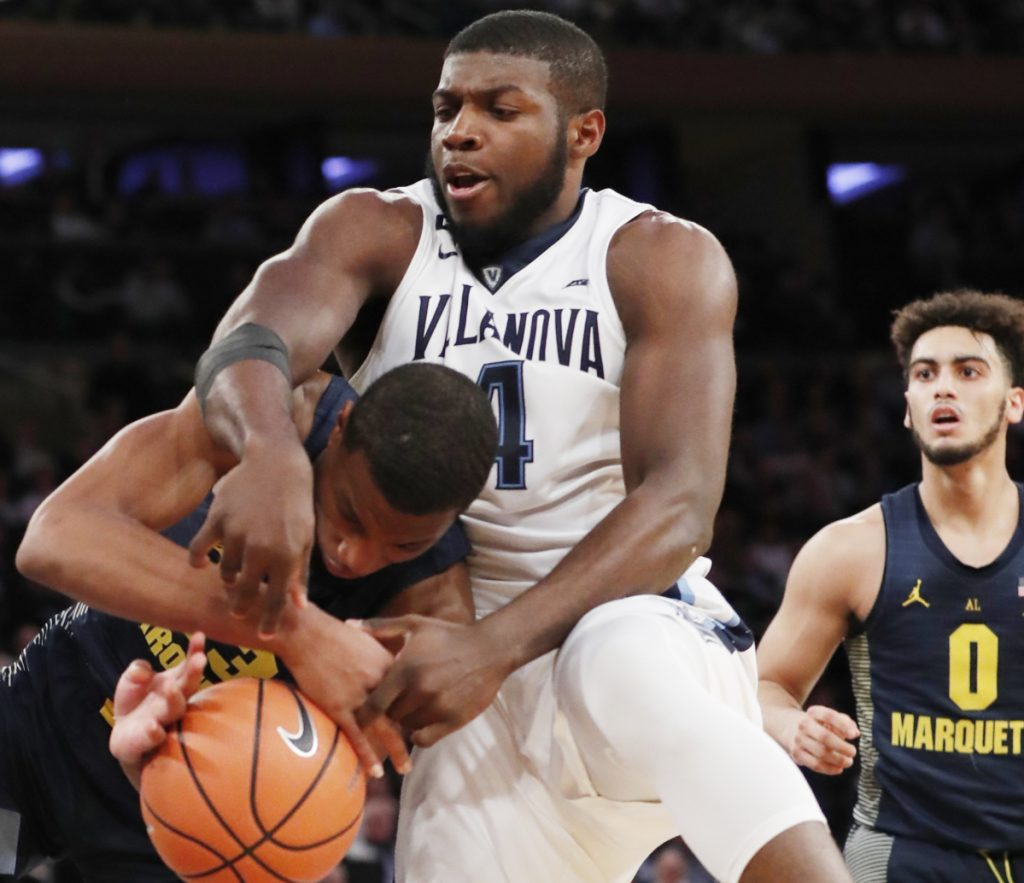 Eric Paschall of Villanova tussles for the ball with Jamal Cain of Marquette during the second half of Villanova's 94-70 victory Thursday night in the Big East quarterfinals at New York.