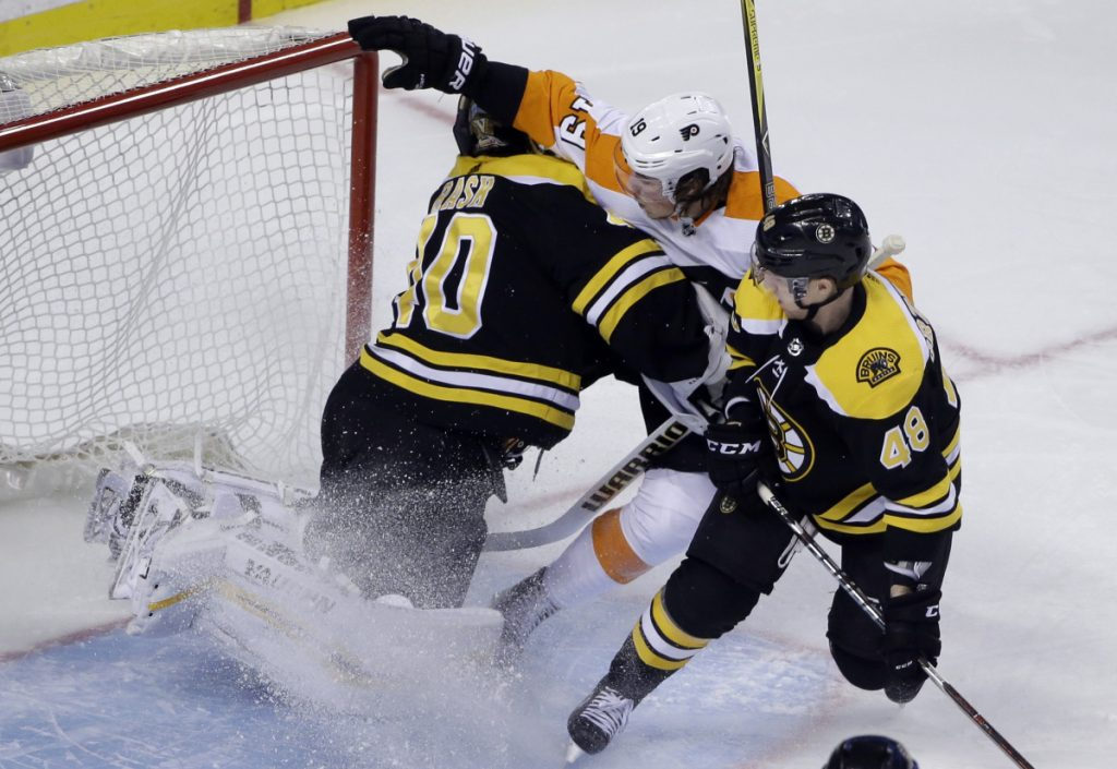Philadelphia Flyers center Nolan Patrick crashes into Boston Bruins goaltender Tuukka Rask during Boston's 3-2 win Thursday night at TD Garden.