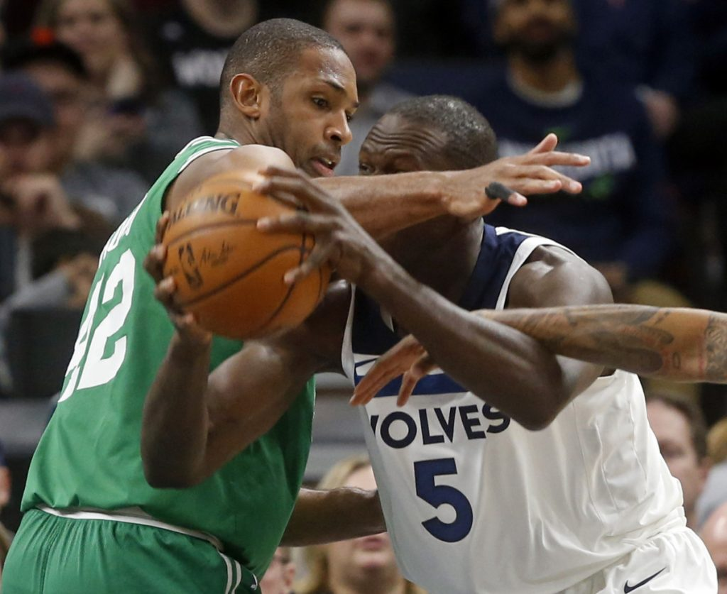 Al Horford, left, of the Celtics defends against Gorgui Dieng of the Minnesota Timberwolves during the first half of the Celtics' 117-109 victory Thursday night.