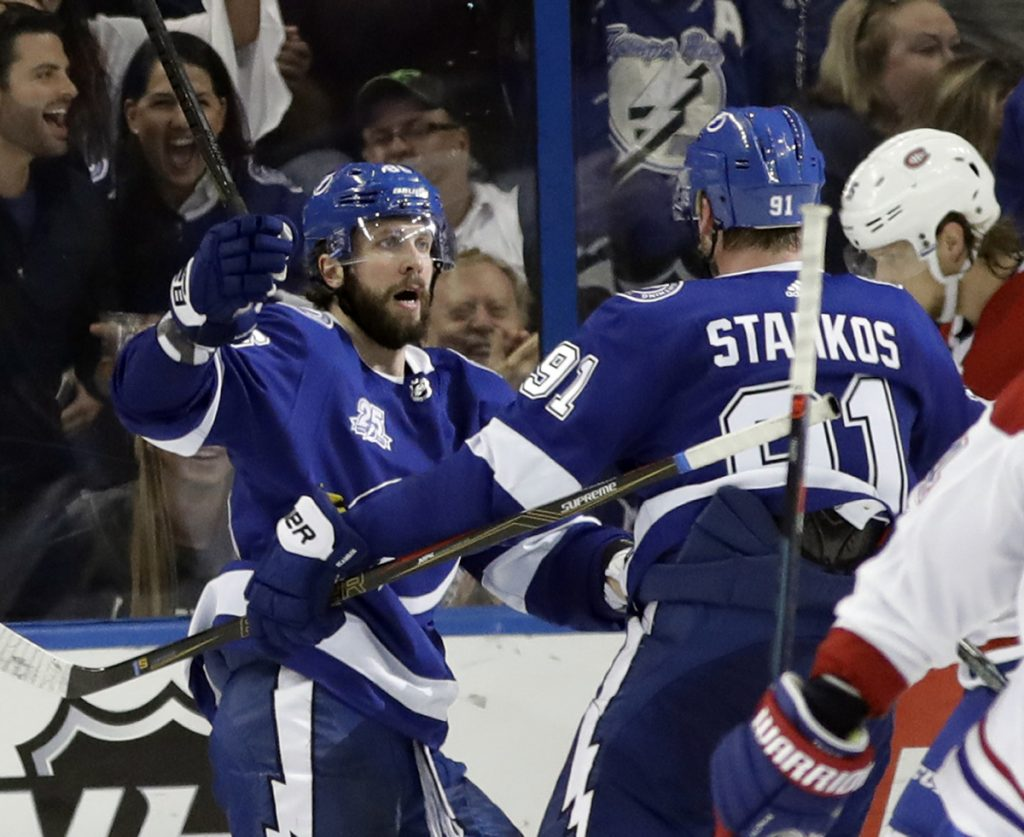 Tampa Bay Lightning right wing Nikita Kucherov, left, celebrates with teammate Steven Stamkos after scoring the tying goal against Montreal in the third period Saturday.