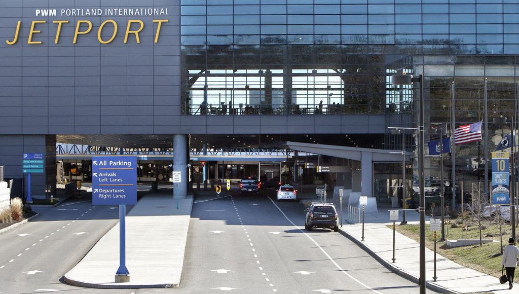 Cars enter into the departures area of the Portland International Jetport on Tuesday, November 24, 2015. (/Staff Photographer)