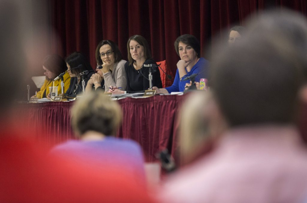 "Scarborough Superintendent Julie Kukenberger, center, listens with board members Jodi Shea, left, and Hillary Durgin, right, as parents and school administrators voice their opinions during a meeting March 12 to discuss later school start times. The teachers' union has taken a vote of ""no confidence"" in the school board and superintendent."