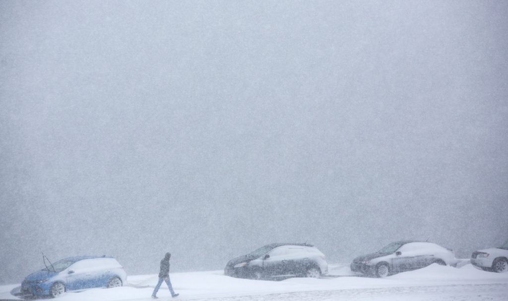 A pedestrian makes his way through wind-driven snow on Portland's Eastern Prom. Before this storm, the city had already gotten almost 2 feet more snow than usual this season.