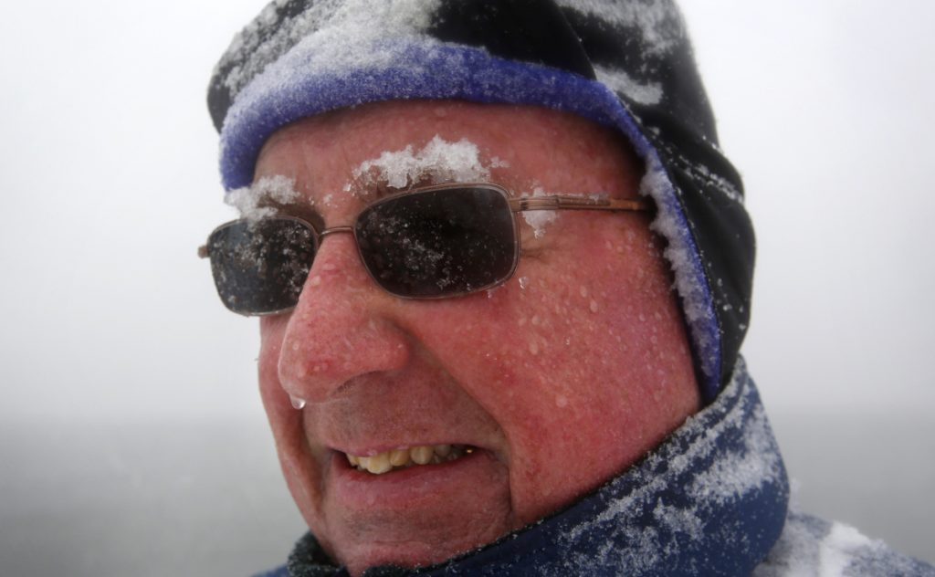 "Snow accumulates on Paul Knight's eyebrows as he walks during a nor'easter, Tuesday, March, 13, 2018, in Portland, Maine. ""It's typical March weather, we're not out of winter yet, that's for sure."" he said. ""The groundhog was right, six more weeks of winter and probably then some..."" (AP Photo/Robert F. Bukaty)"
