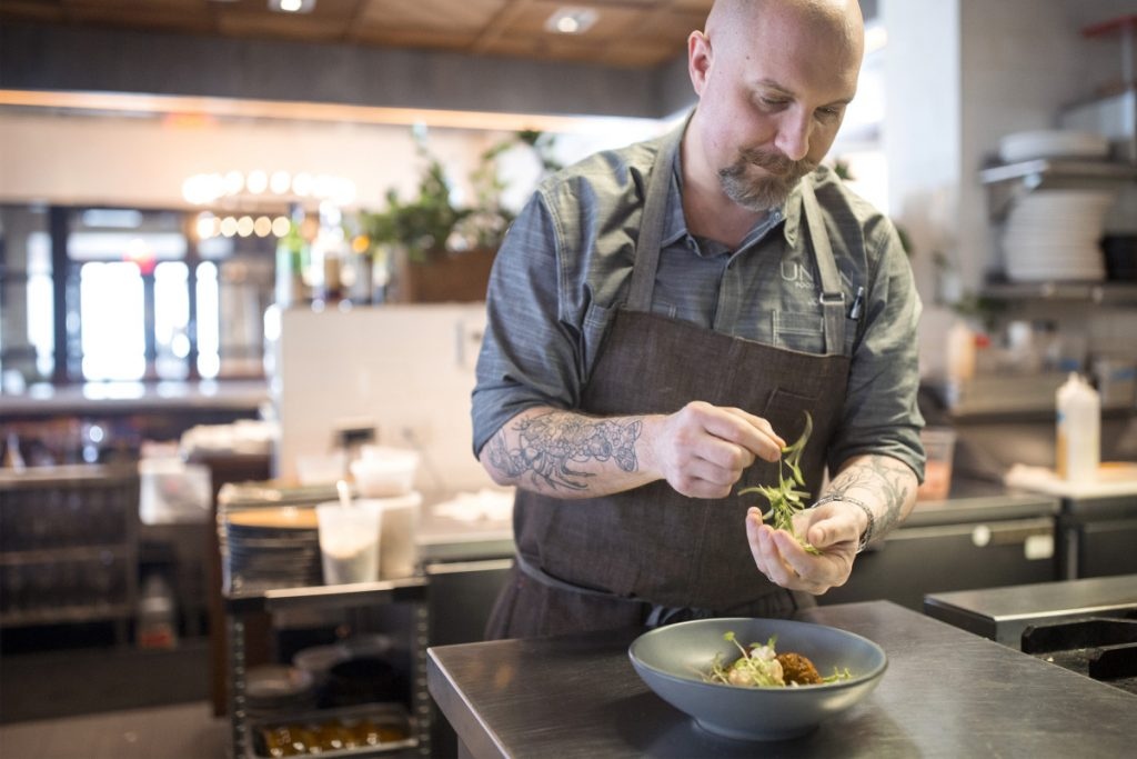 Chef Josh Berry Garnishes Toasted Pea Falafel With Roast Cauliflower At Union The Dish Is