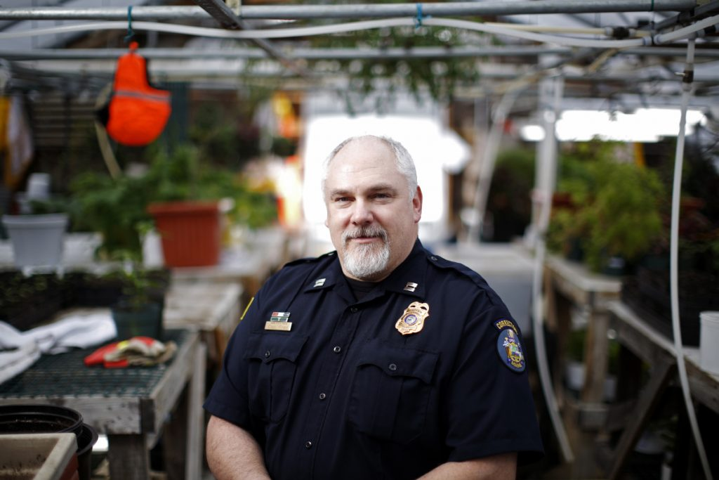 Ryan Fries, a captain at Maine State Prison in Warren, in a greenhouse where inmates work raising plants.