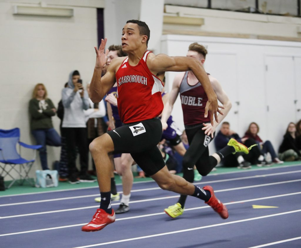 Jared Flaker of Scarborough sprints to the finish in the 55 meters at the Class A state championships. His time of 6.50 seconds was just one of the records that fell during a dominating indoor track season.