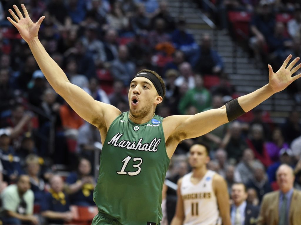 Jarrod West of Marshall reacts Friday as time runs out and the 13th-seeded Thundering Herd advance to the Round of 32, winning an NCAA tournament game for the first time by shocking fourth-seeded Wichita State 81-75 in the East Regional at San Diego.