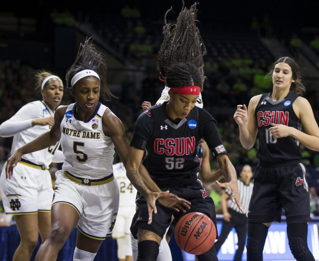 Notre Dame's Jackie Young tries to knock the ball away from Eliza Matthews of Cal State Northridge during Notre Dame's 99-81 victory Friday in South Bend, Indiana.