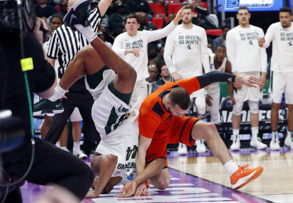 Nick Ward of Michigan State lands on his head Friday night after colliding with Kimbal Mackenzie of Bucknell during the second half of Michigan State's 82-78 victory at Detroit.