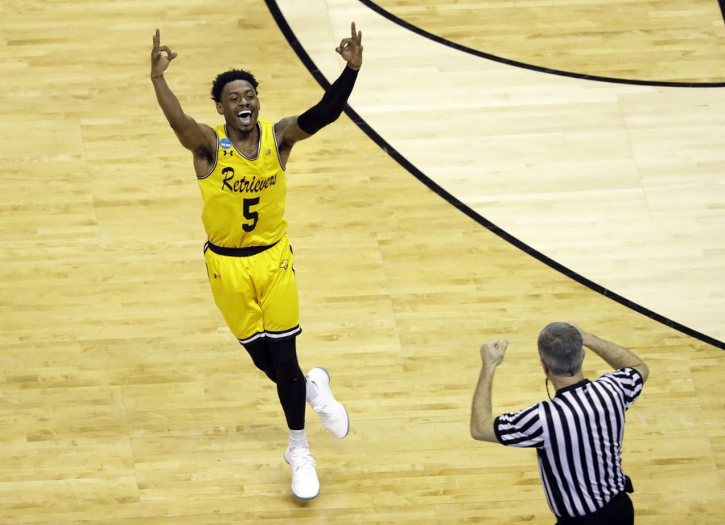 UMBC's Jourdan Grant celebrates after a basket against Virginia during the second half Friday night in Charlotte, N.C. The Retrievers won the game, 74-54.