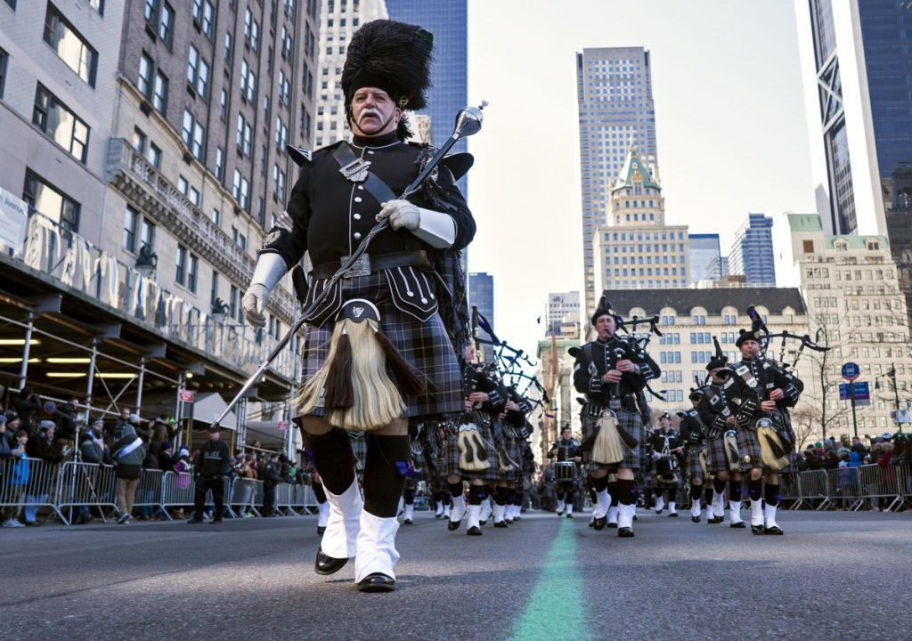 A bagpipe unit representing the New York State Police takes part in the St. Patrick's Day parade on Fifth Avenue in New York on Saturday. Several bagpipe bands led a parade made up of over 100 marching bands after Democratic Gov. Andrew Cuomo spoke briefly, calling it a