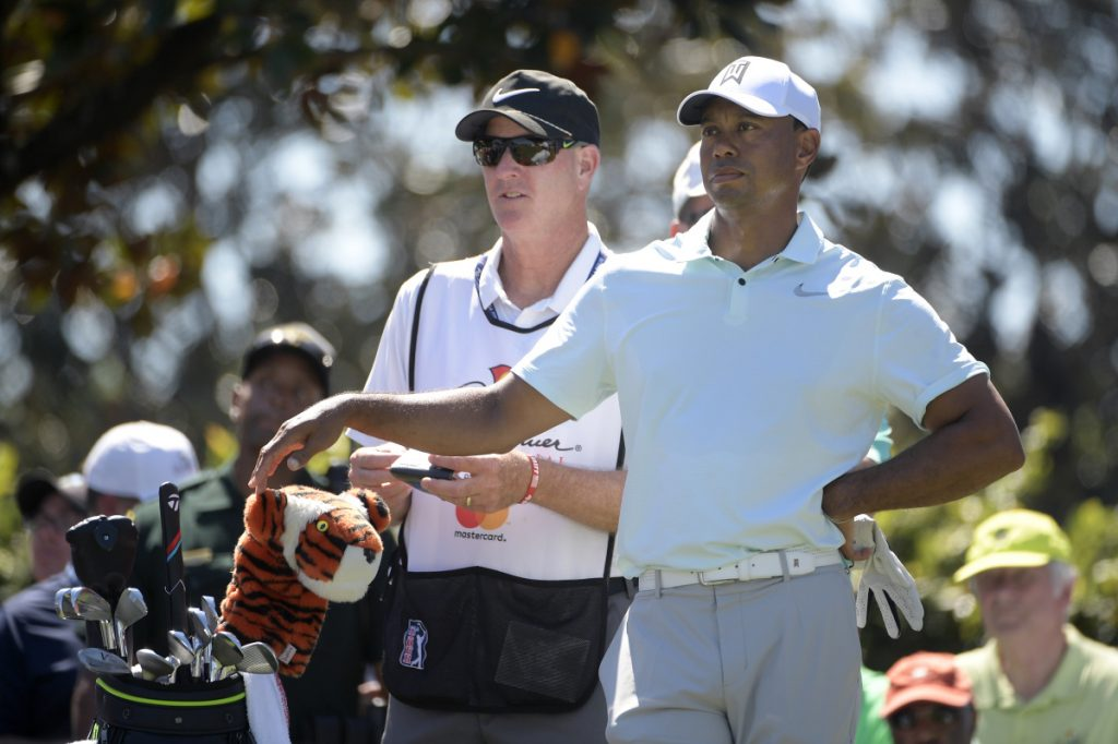 Tiger Woods, right, stayed in contention Saturday at the Arnold Palmer Invitational by shooting a 3-under 69, leaving him five shots behind Henrik Stenson.