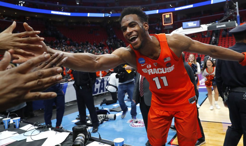 Oshae Brissett of Syracuse celebrates with fans Sunday after the Orange – the final at-large team selected for the NCAA tournament – upset Michigan State 55-53 to advance to the regional semifinals and a game against Duke.