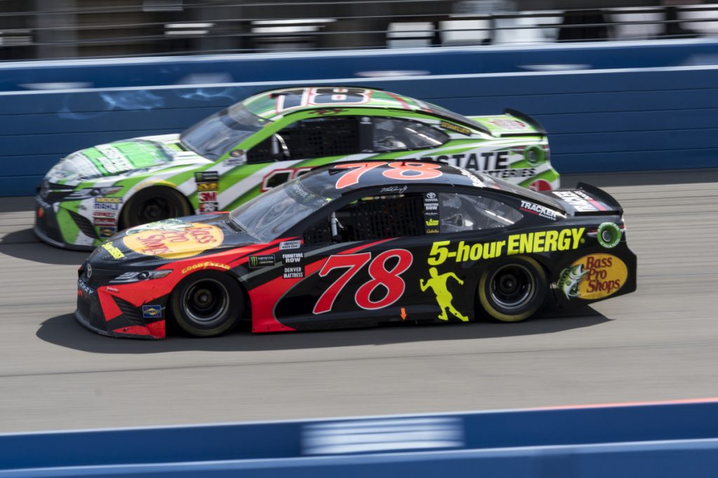 Martin Truex Jr., front, battles Kyle Busch for the lead with during Sunday's Cup Series race in Fontana, Calif. Truex took the lead from Busch with 32 laps remaining and went on to his first victory of the season.