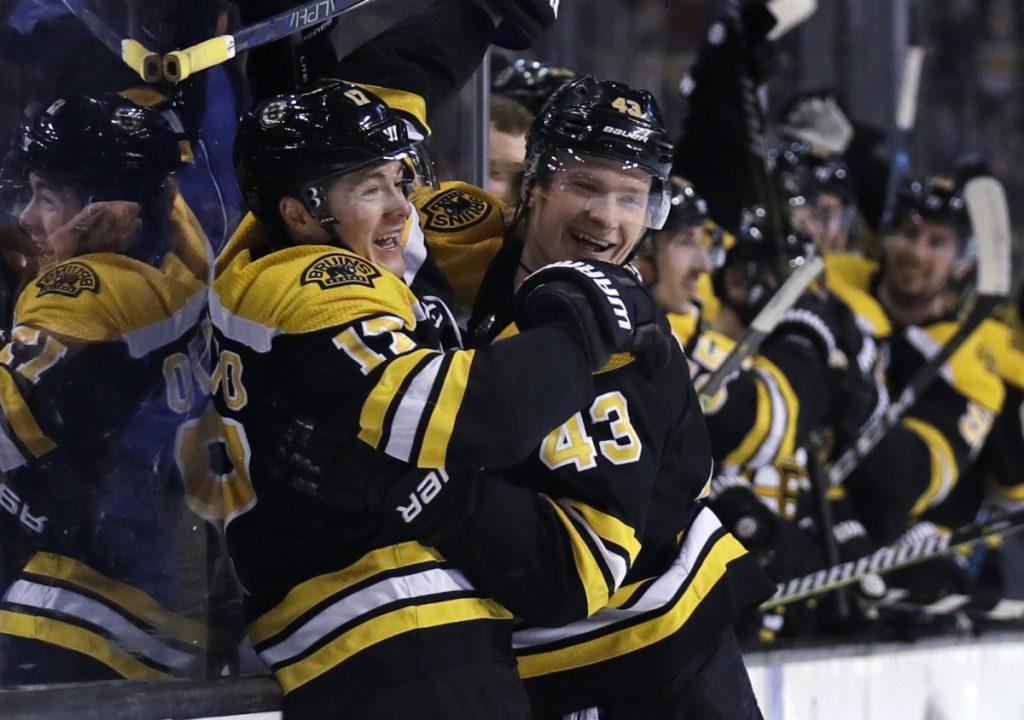 Bruins forward Ryan Donato, left, is congratulated by Danton Heinen after scoring in his NHL debut, a 5-4 OT loss to Columbus on Monday night.