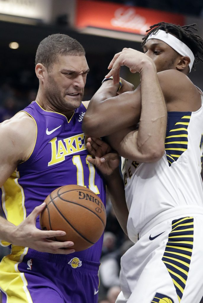 Brook Lopez of the Los Angeles Lakers goes to the basket against Myles Turner of the Indiana Pacers in the first half Monday night.