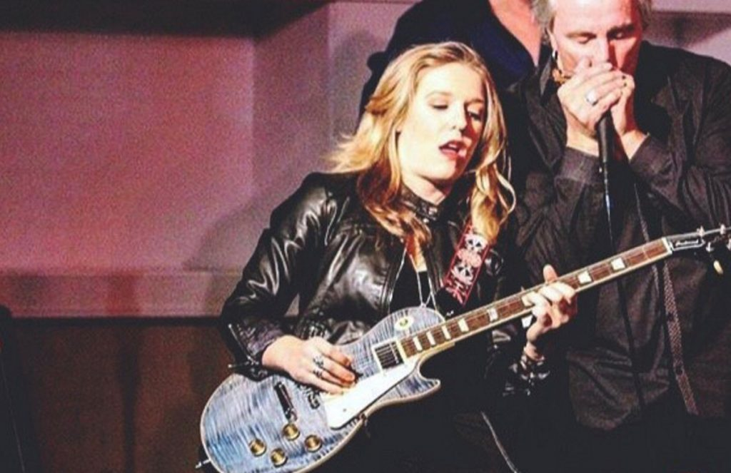 "Allivia Lorusso of Ogunquit performs onstage with well-known blues musician James Montgomery. Her cover of Aerosmith's ""Walk This Way"" was shared by the band on social media. Lorusso says it has her favorite guitar solo."