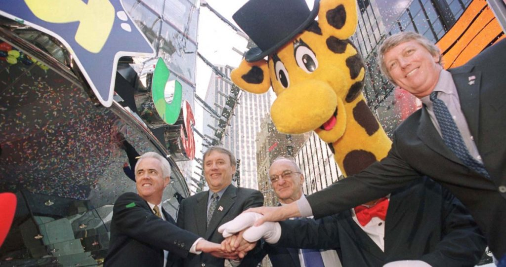Toys R Us founder Charles Lazarus is shown second from right at the 2001 grand opening of the Toys R Us store in New York's Times Square. Also pictured, from left, are Elliott Wahle, vice president and general manager of the new store; John Eyler, chairman, president and CEO; and Gregory Staley, president, U.S. toy stores.