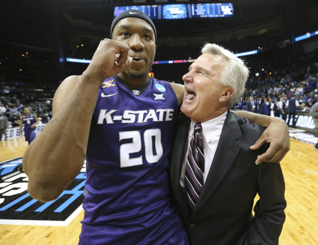 Kansas State Coach Bruce Weber and forward Xavier Sneed celebrate a 61-58 win over Kentucky in an NCAA men's basketball tournament late Thursday night.