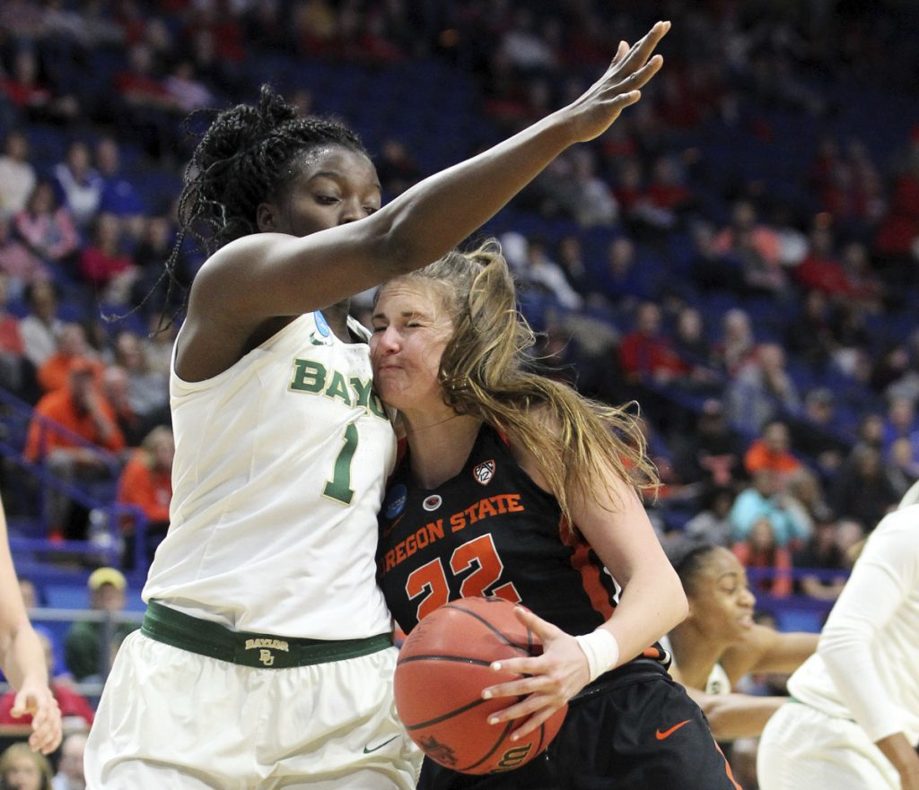 Kat Tudor of Oregon State collides with Dekeiya Cohen of Baylor while trying to drive Friday. Oregon State won, 72-67.