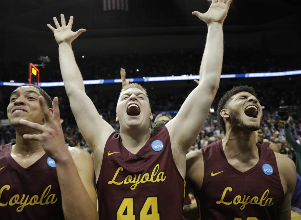 Loyola's Lucas Williamson, Nick Dinardi and Christian Negron, from left, celebrate Saturday night after earning a berth in the Final Four with a 78-62 victory against Kansas State.