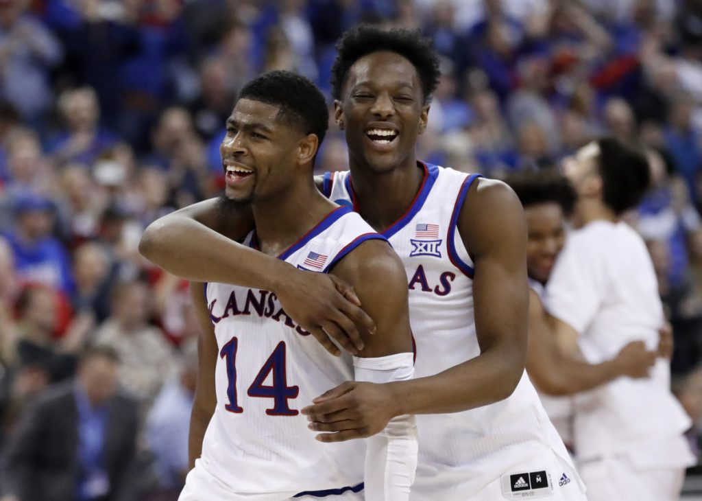 Kansas' Malik Newman, left, and Marcus Garrett celebrate after the Jayhawks beat Duke 85-81 in overtime to win Midwest regional in the NCAA men's basketball tournament on Sunday in Omaha, Nebraska.
