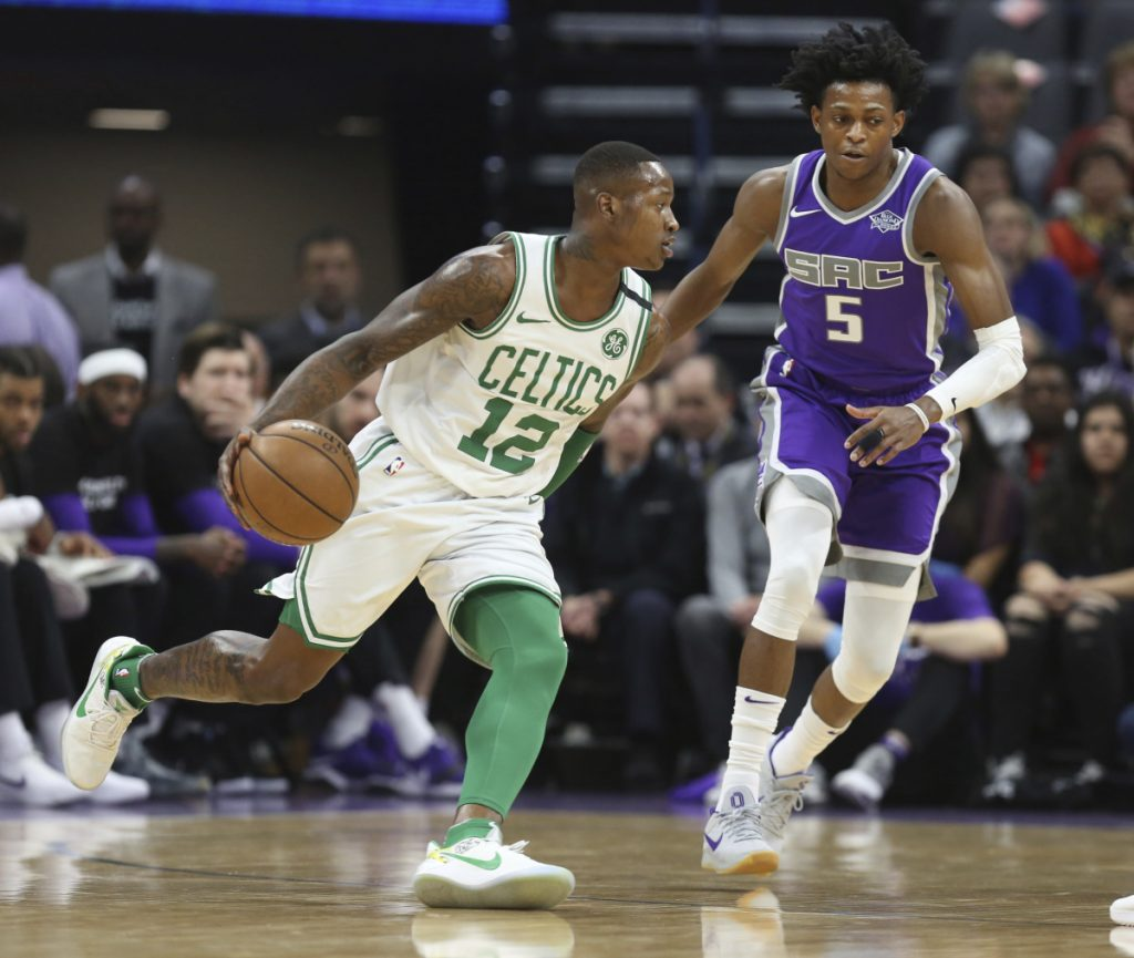 Celtics guard Terry Rozier drives around Kings guard De'Aaron Fox during Boston's 104-93 win Sunday in Sacramento, California.