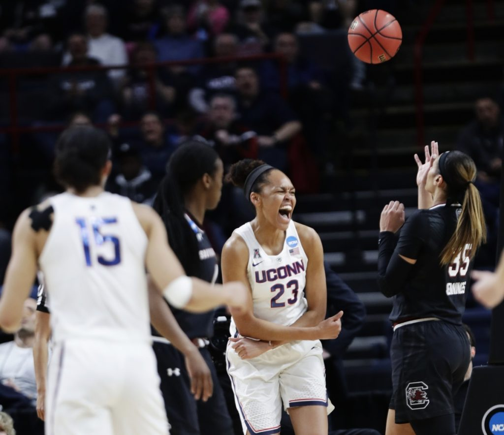 Connecticut's Azura Stevens celebrates after scoring in the first half of the Huskies' 94-65 win over South Carolina in the Albany Regional final Monday in Albany, New York.