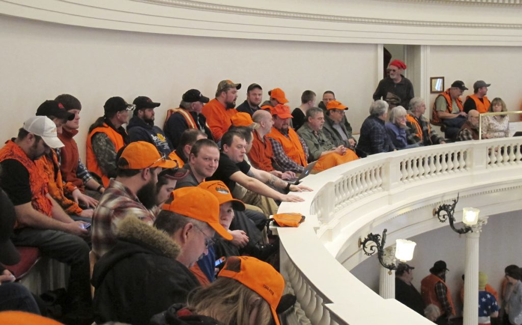 Gun control opponents wearing hunter orange pack the gallery in the Vermont House of Representatives on Tuesday in Montpelier, Vt.