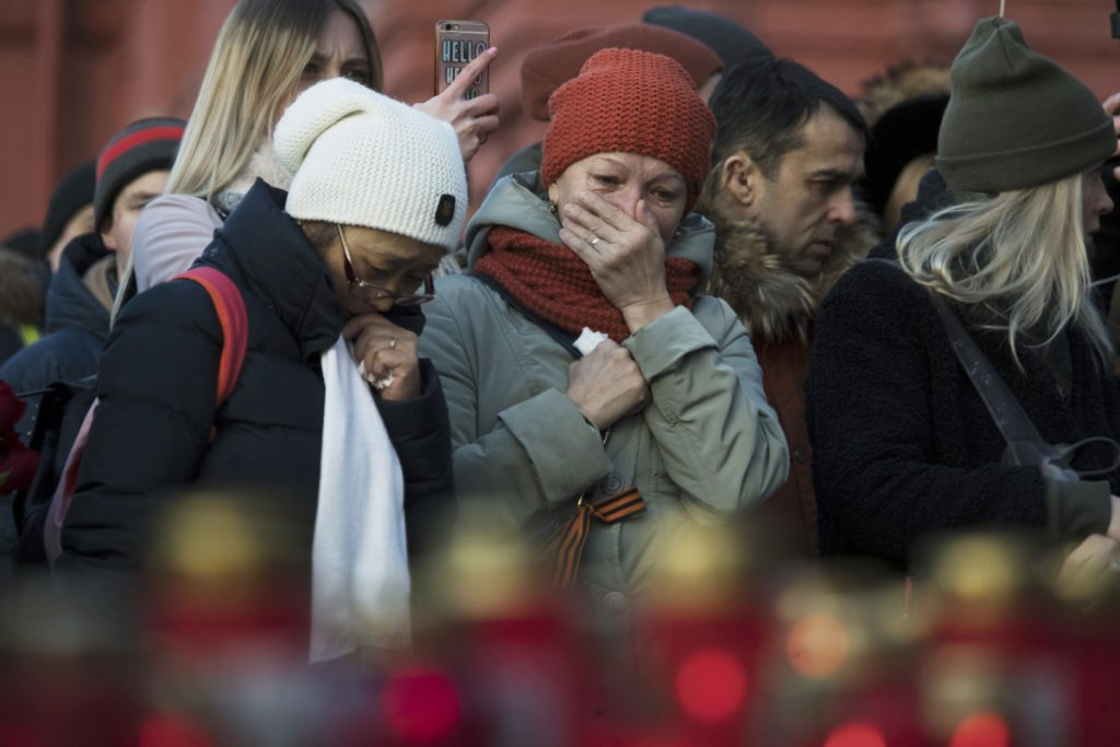 Demonstrators gather Tuesday at a memorial in Moscow to mourn 64 people killed in a fire at a shopping mall in the Siberian city of Kemerovo.