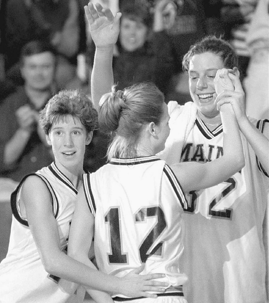 Stacey Porrini Clingan, right, was a top rebounder and shot blocker while helping Maine win the America East basketball title her final three seasons with the Black Bears, along with teammates Cindy Blodgett, left, and Kelly Stubbs, center.