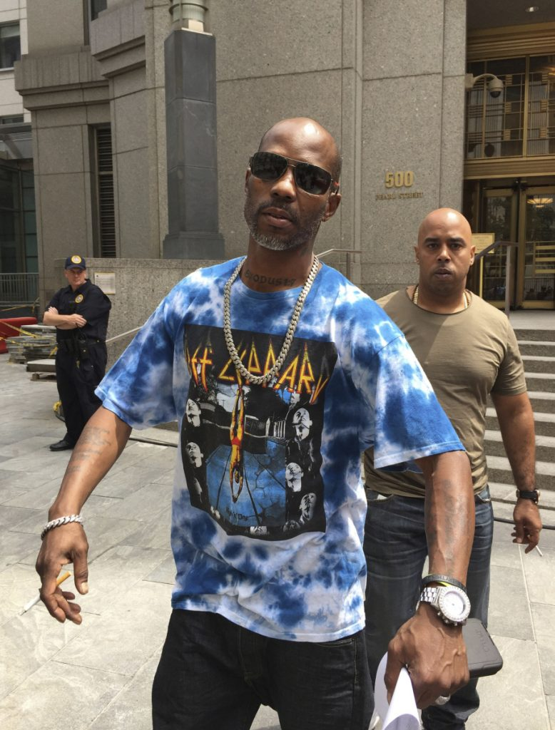 DMX smokes a cigarette after leaving Manhattan federal court in New York following an appearance in his tax fraud case. DMX  was sentenced to a year in prison for trying to dodge $1.7 million in taxes.