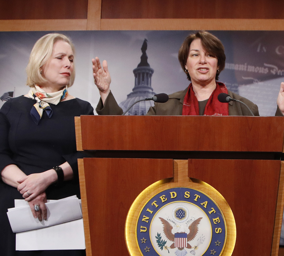 Sen. Amy Klobuchar, D-Minn., right, and Sen. Kirsten Gillibrand, D-N.Y., are helping to lead an effort in the Senate to update rules on sexual harassment and discrimination.