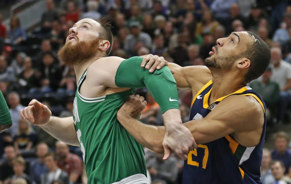 Boston center Aron Baynes and Utah center Rudy Gobert battle under the boards for a rebound Wednesday night in Salt Lake City.