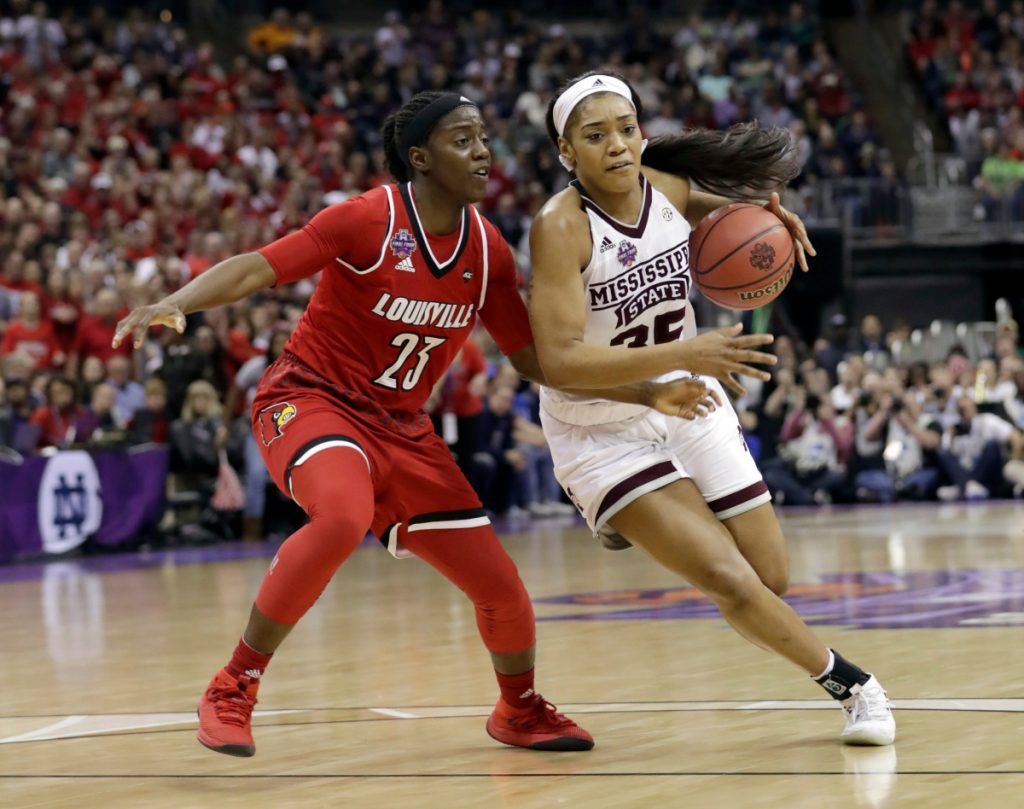 Mississippi State's Victoria Vivians goes to the basket against Louisville's Jazmine Jones during the second half of the Bulldogs' 73-63 win in the Final Four on Friday in Columbus, Ohio.