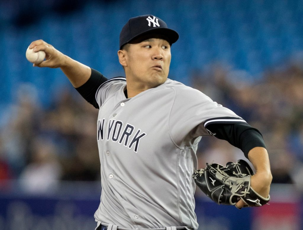 Masahiro Tanaka pitched six innings and the Yankees beat the Blue Jays 4-2 on Friday in Toronto.