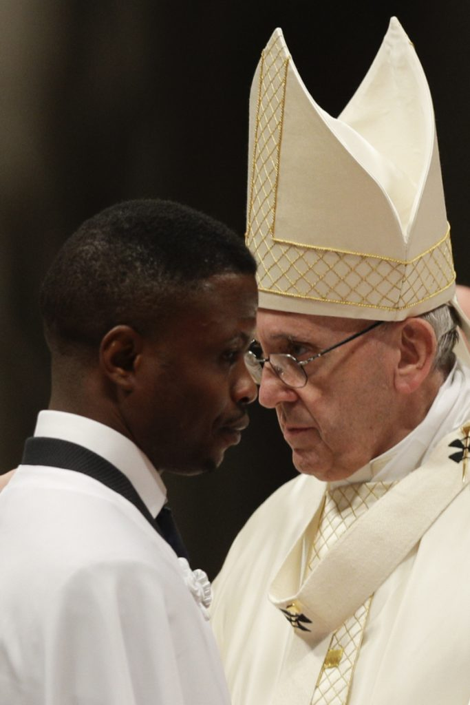 John Ogah passes by Pope Francis after being baptized Saturday. Ogah also now has a job and a home.