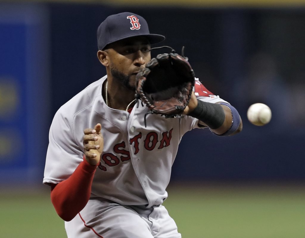 Red Sox third baseman Eduardo Nunez fields a ground ball by Tampa Bay's Carlos Gomez during the first inning Saturday in St. Petersburg, Fla. The Red Sox improved to 2-1 with a 3-2 victory.