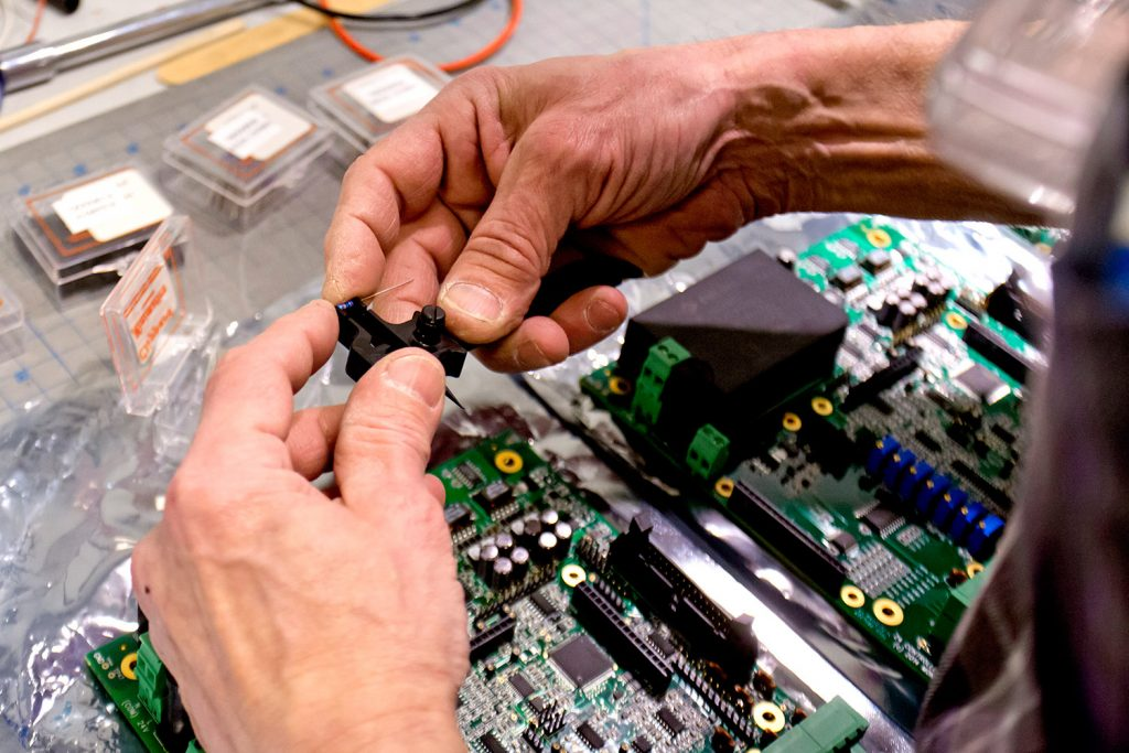 A technician at Montalvo Corporation in Gorham assembles the inside of a Z4 tension controller in 2015.