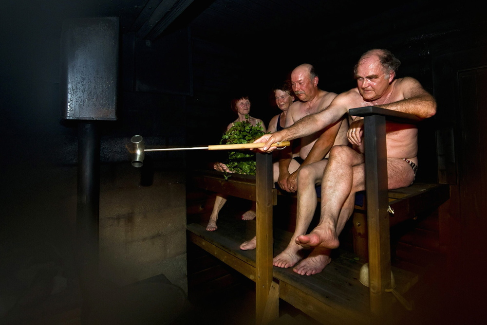 People sit in a sauna in Leppavirta, central Finland. They're lucky to be in the world's happiest country.