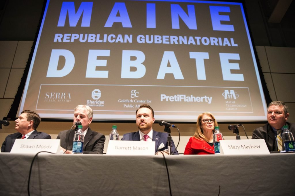 Republican candidates for governor, from left to right, Ken Fredette, Shawn Moody, Garrett Mason, Mary Mayhew, and Mike Thibodeau begin a debate at Ostrove Auditorium at the Diamond Building at Colby College in Waterville.